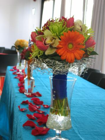 Green spider mums, orange gerbera daisies, pink tulips, and green cymbidium orchids. Wedding at Des Moines Botanical Center.