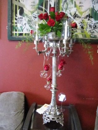 Our Victorian Candelabra with red roses. Event at Des Moines Social Club.