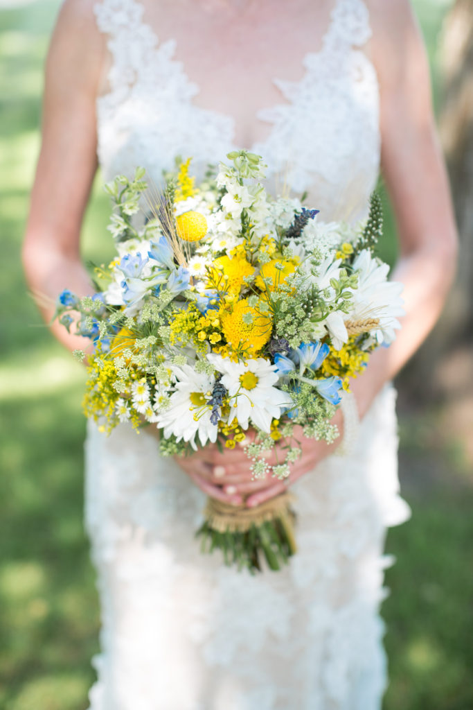 Bridal bouquet yellow, white and blue Photo by Blind Photography